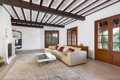 Wooden windows, doors and ceiling beams provide a cosy atmosphere