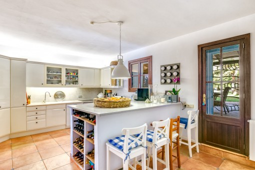 The fully equipped kitchen offers access to the outside
