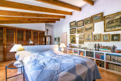 Impressive bedroom with large wardrobes and many books