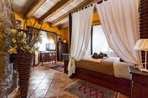Capacious master bedroom with four-poster bed