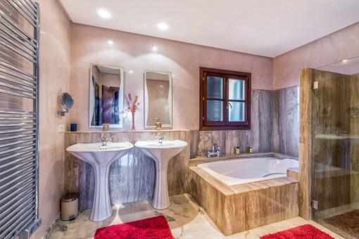 Luxurious master bathroom with large bathtub