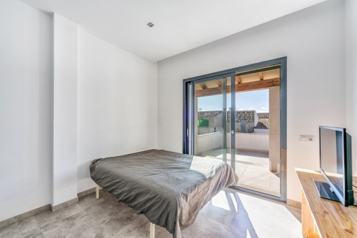 One out of 4 bedrooms with balcony access