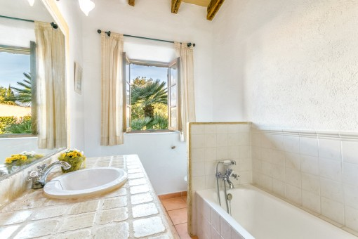 Second bathroom with bathtub and natural light