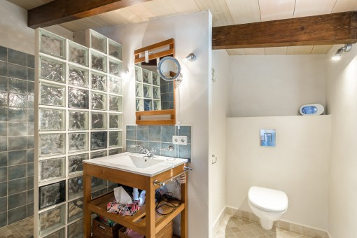 One out of 3 bathrooms with shower