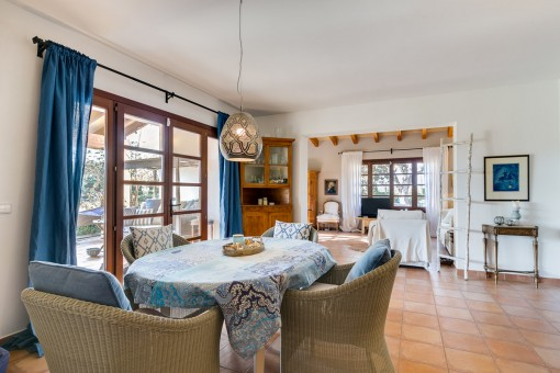 Open living and dining area with terrace access