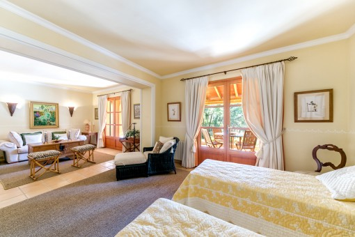 The lovely bedroom offers a living area and terrace access
