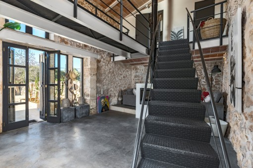 A staircase leads to the first floor