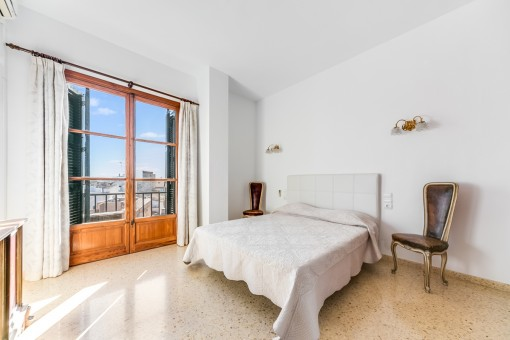 One of 3 bedrooms with views to the main square