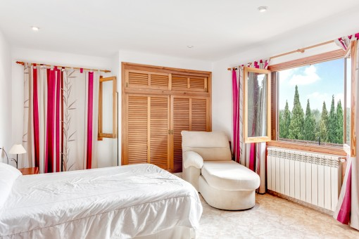 Master bedroom with garden views on the upper floor