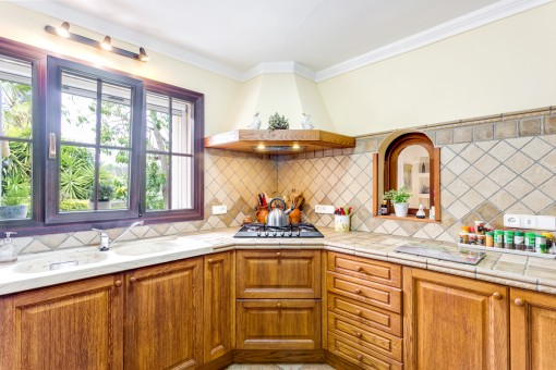 Lovely country house kitchen with wooden cupborads