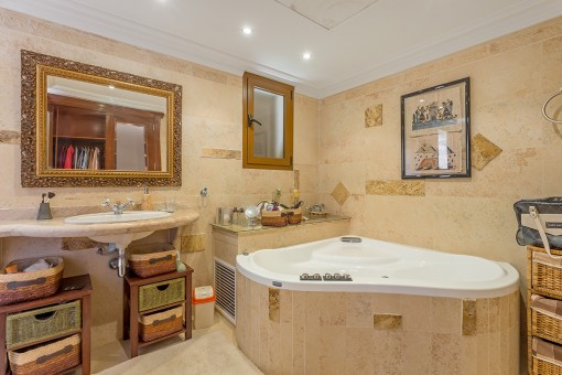 Master bathroom with large hydro-massage bathtub
