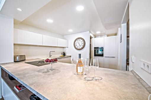 The luxurious kitchen is equipped with good appliances