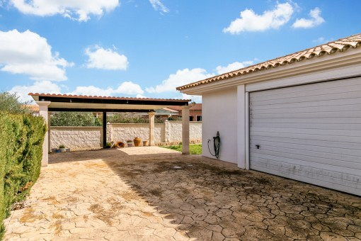 The villa offers a double-garage and a carport