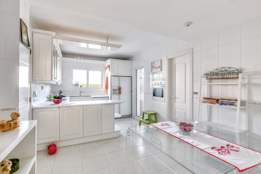 Large kitchen with dining area and storage room