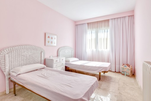 One of 4 bright bedrooms