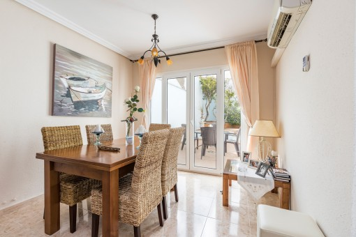 Bright dining area with access to the patio