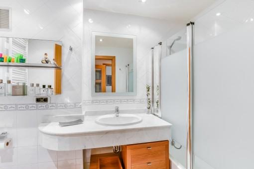 Further bathroom with bathtub