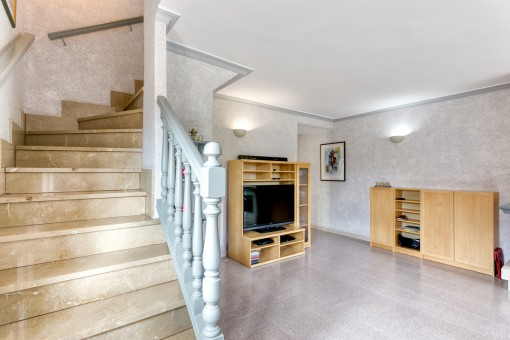 A staircase leads from the living area to the upper floor