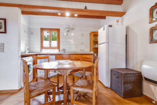 Fully equipped kitchen with dining area and wooden ceiling beams