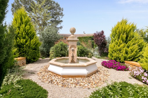 Romantic fountain in the garden