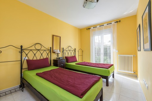 The third bedroom in warm colours