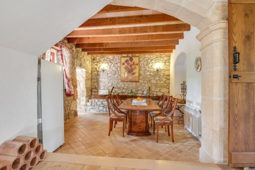 Authentic dining area with natural stone wall