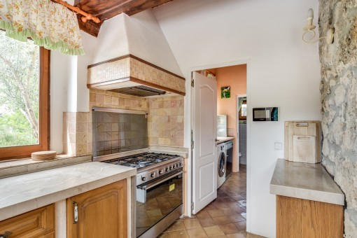 The kitchen offers a separate storage and washing room