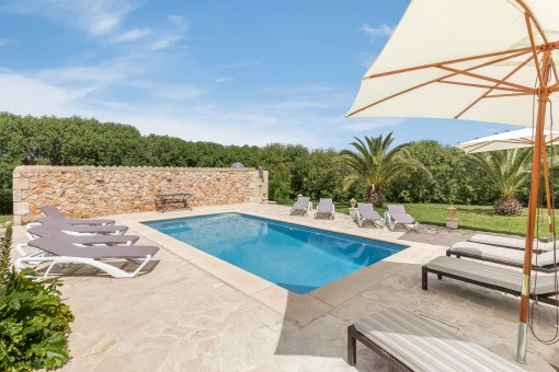 The pool area invites to relax during summer days