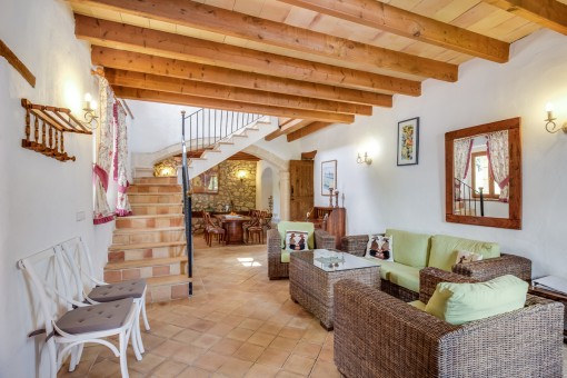 Beautiful living and dining area with wooden ceiling beams