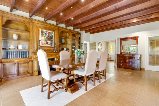 Large dining area with fireplace and wooden ceiling