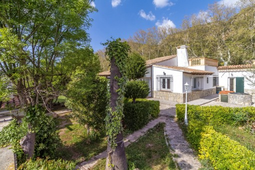 The villa is surrounded by a picturesque garden