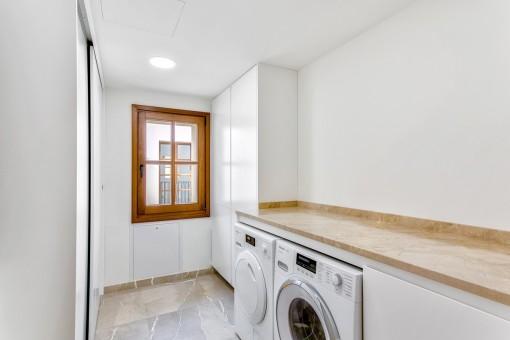 Utility room with washing machine
