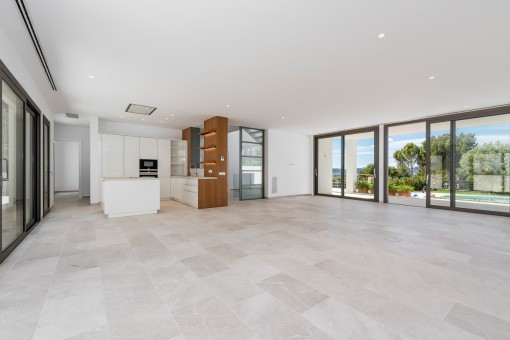 Bright and spacious living area with access to the pool area
