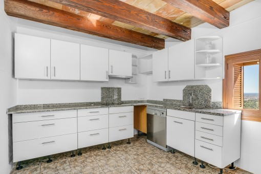 Kitchen with wooden ceiling beams