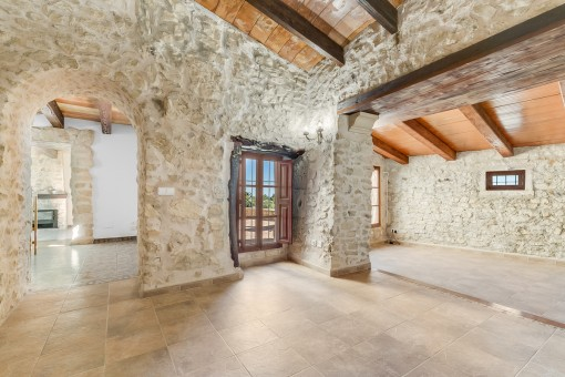 Impressive living and dining area with stone walls