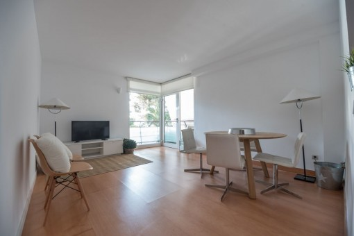 Spacious living and dining area with access to a terrace