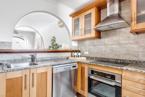 Fully equipped kitchen with pass-through to the living area