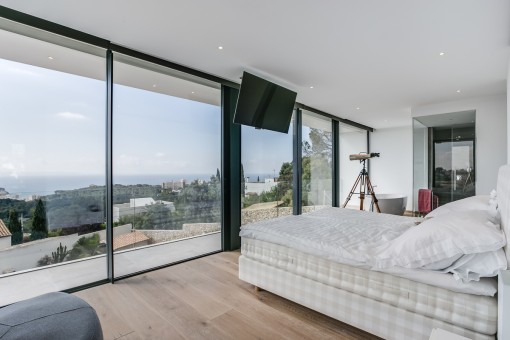 Luxury guest bedroom with panoramic views