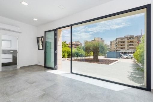 The ground floor houses a bright office