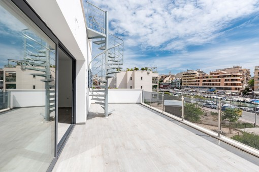 A spiral staircase leads to the roof terrace