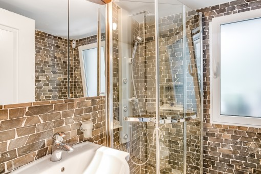 Beautiful bathroom with natural stone walls