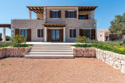 Newly-built natural-stone finca near Santanyi with pool in an idyllic location with wonderful countryside and sea views