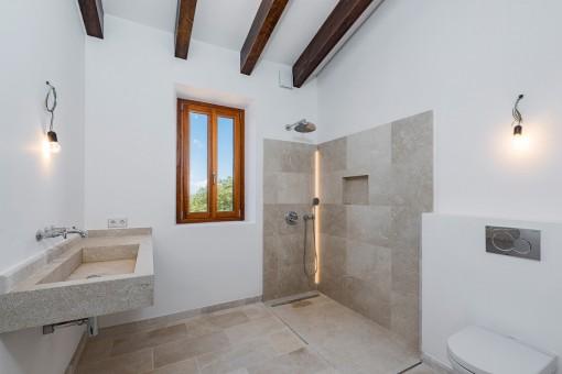Bright bathroom with wooden beams