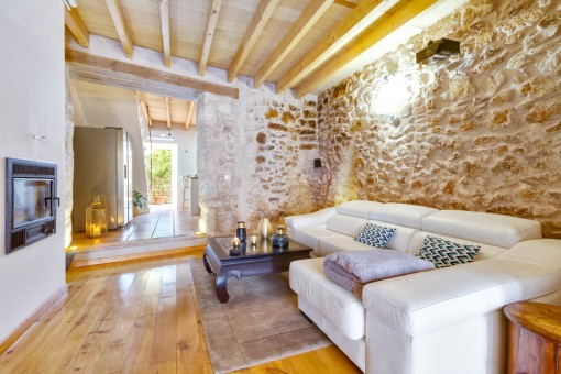 Cosy living area with natural stone wall