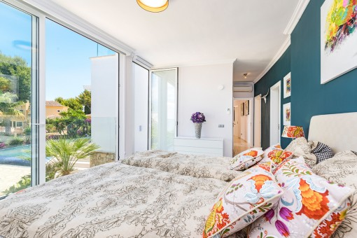 Second bedroom with pool views