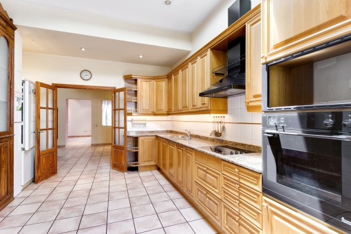The fully equipped kitchen offers ample space