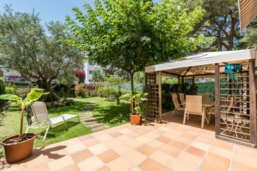 Sunny terrace with partly covered dining area