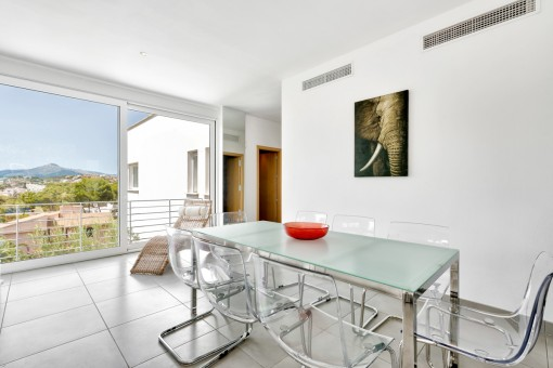 Dining area with table of glass