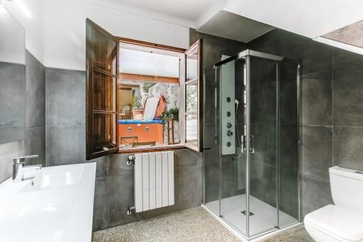Bathroom with shower and heating
