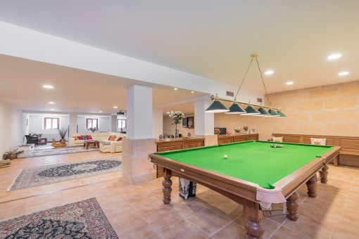 Extensive poolroom with lounge area